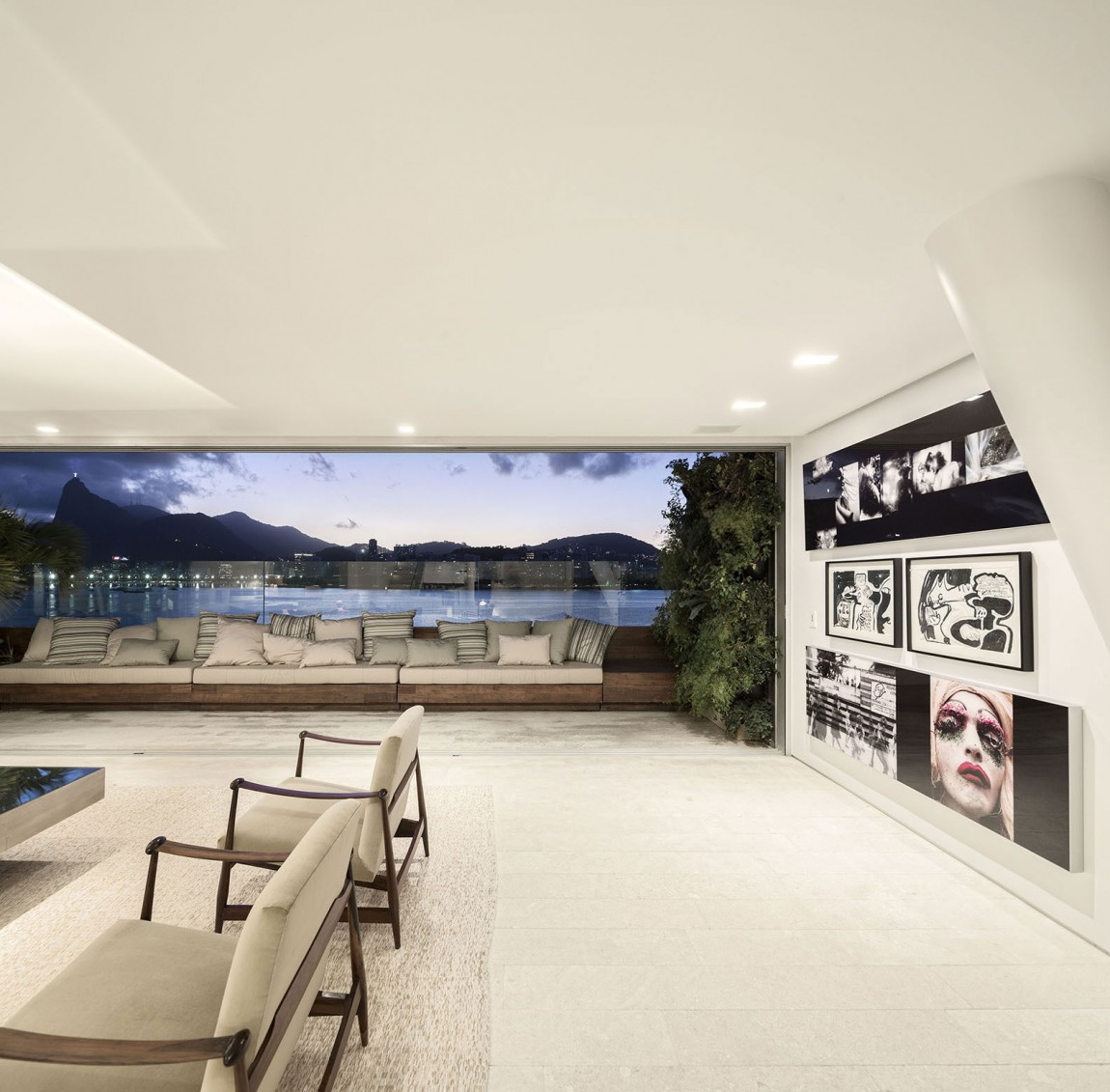 Contemporary art and plush seating add a new dimension to the room