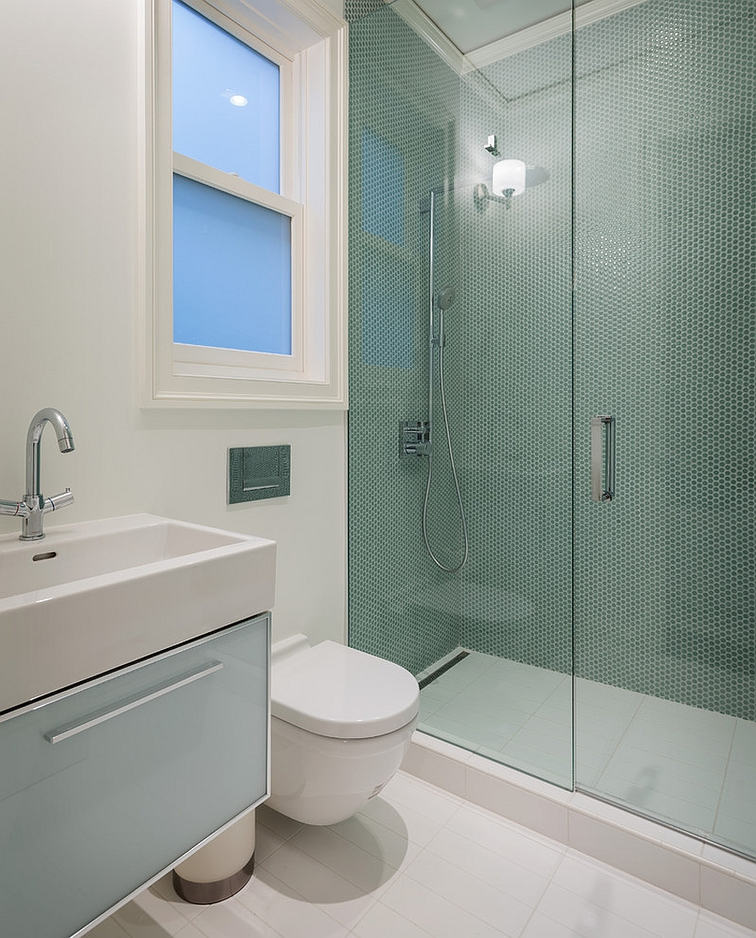 Green penny tiles for the smart shower area [Design: Sutro Architects]
