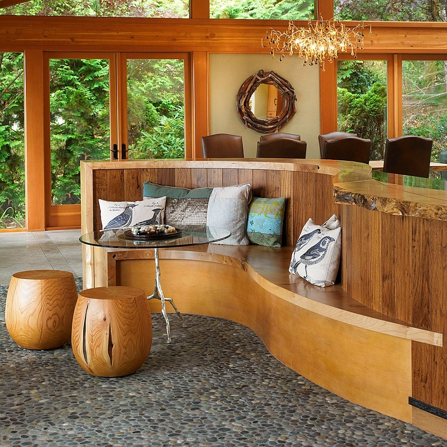 Kitchen island extends to shape a built-in banquette