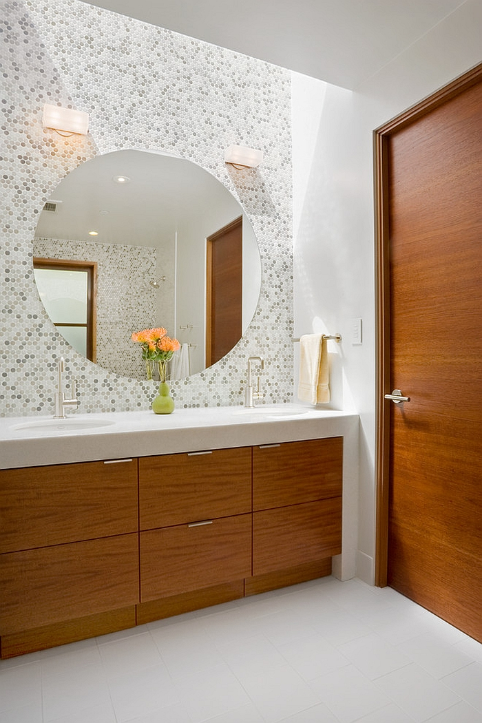 Large round mirror above the bathroom vanity [Design: William Duff Architects]