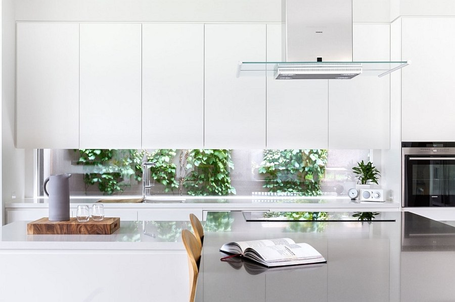 Minimal style cabinets and a wide window give the kitchen a modern appeal