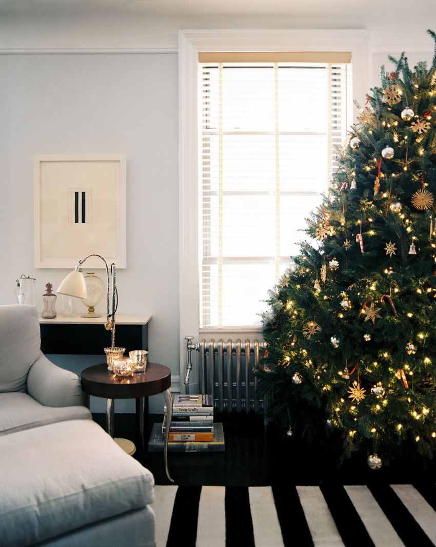 Modern Christmas tree with straw ornaments