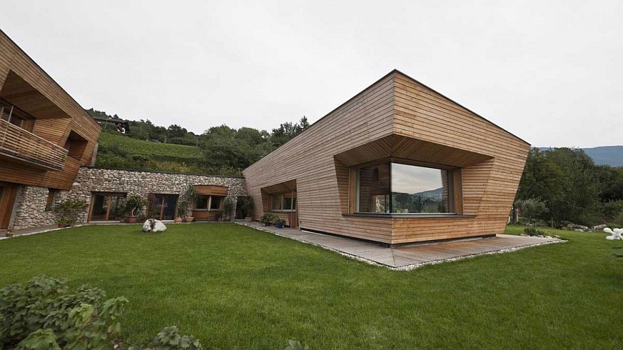 Contemporary exterior of the home blends in with the scenic landscape