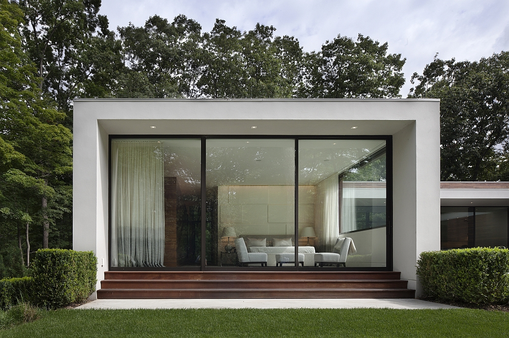 Contemporary silhouette of the home stands out in the forest backdrop