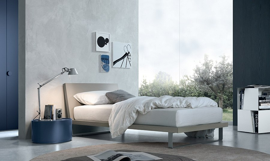 Cool circular nightstand in blue adds playful elegance to the room