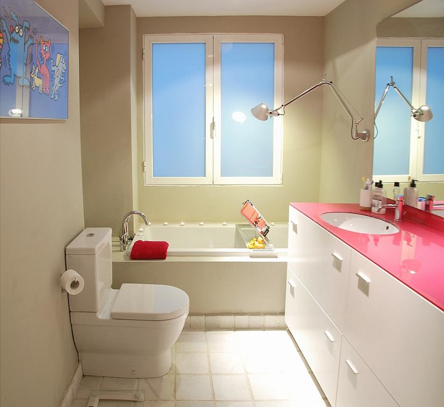 Custom fuchsia glass top adds aura of hot pink to the bathroom