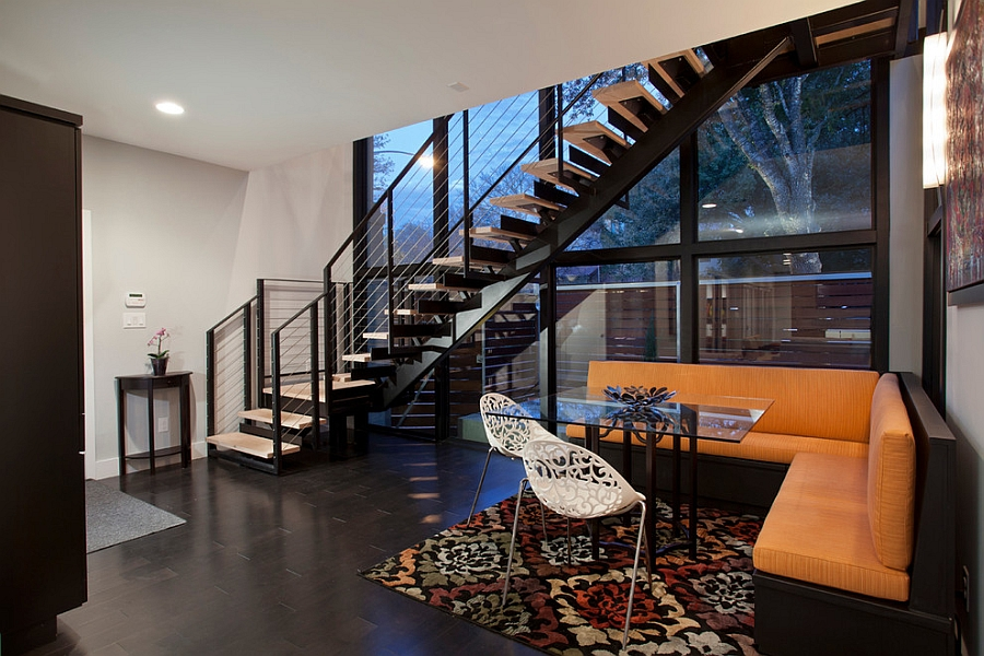 Dining room makes wonderful use of space under the staircase