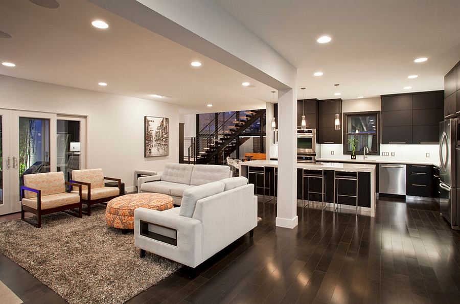 Dark wooden flooring brings an air of sophistication to the room