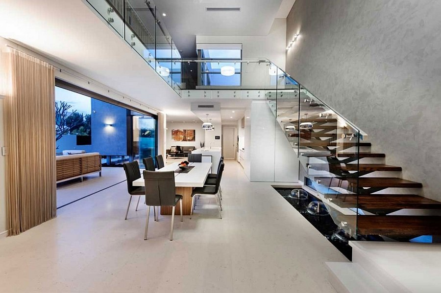 Elegant staircase with glass rail and wooden steps steals the show