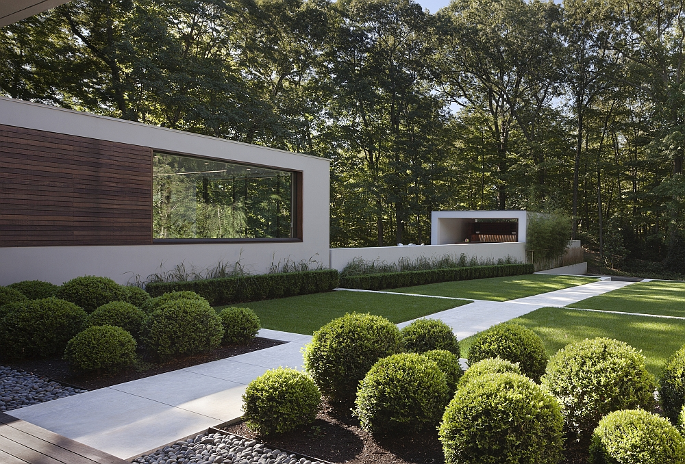 Fabulous walkways and curated gardens surround the renovated home
