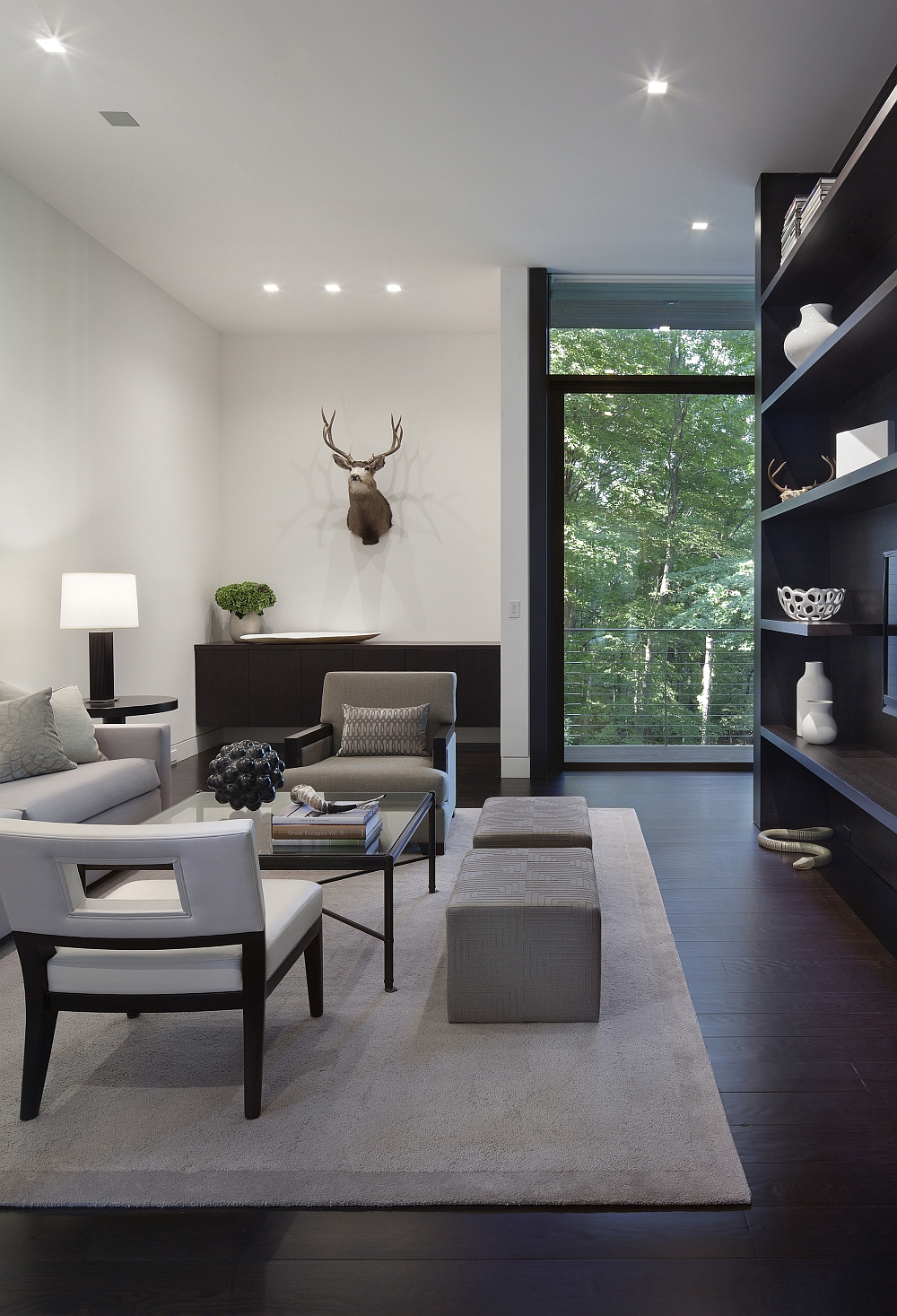 Family area with cube ottomans and open shelves