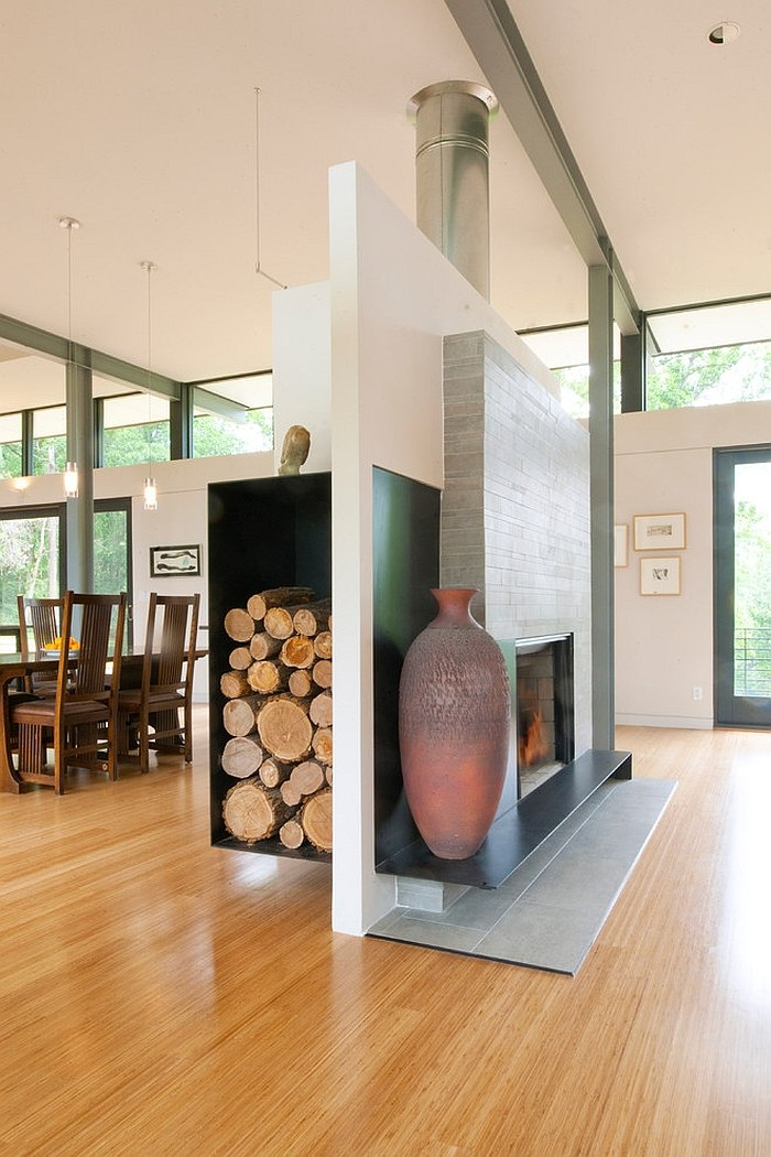 Fireplace and floating wood storage unit separate the living and dining rooms