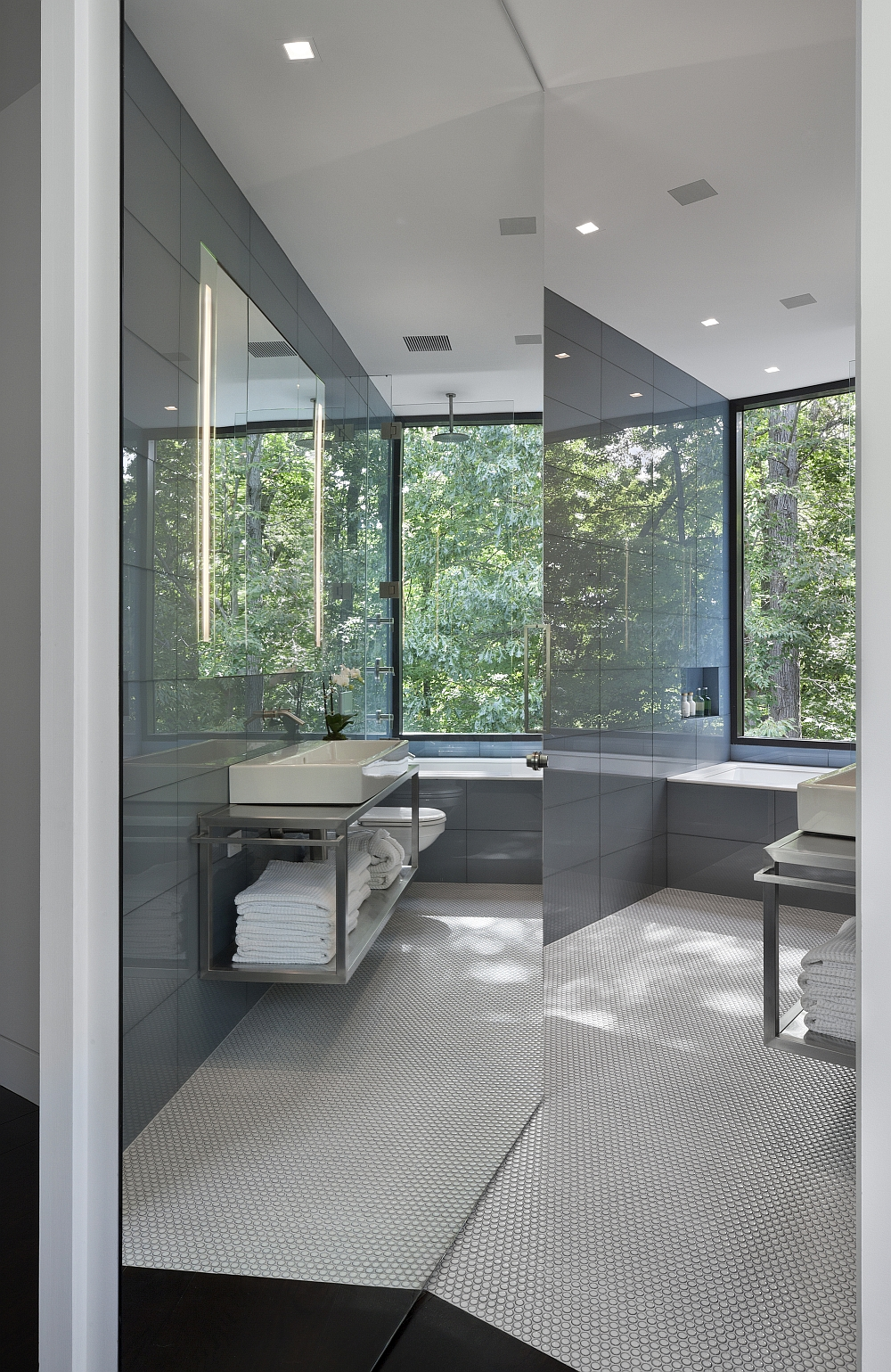 Glass surfaces give even the smallest of spaces a more airy look