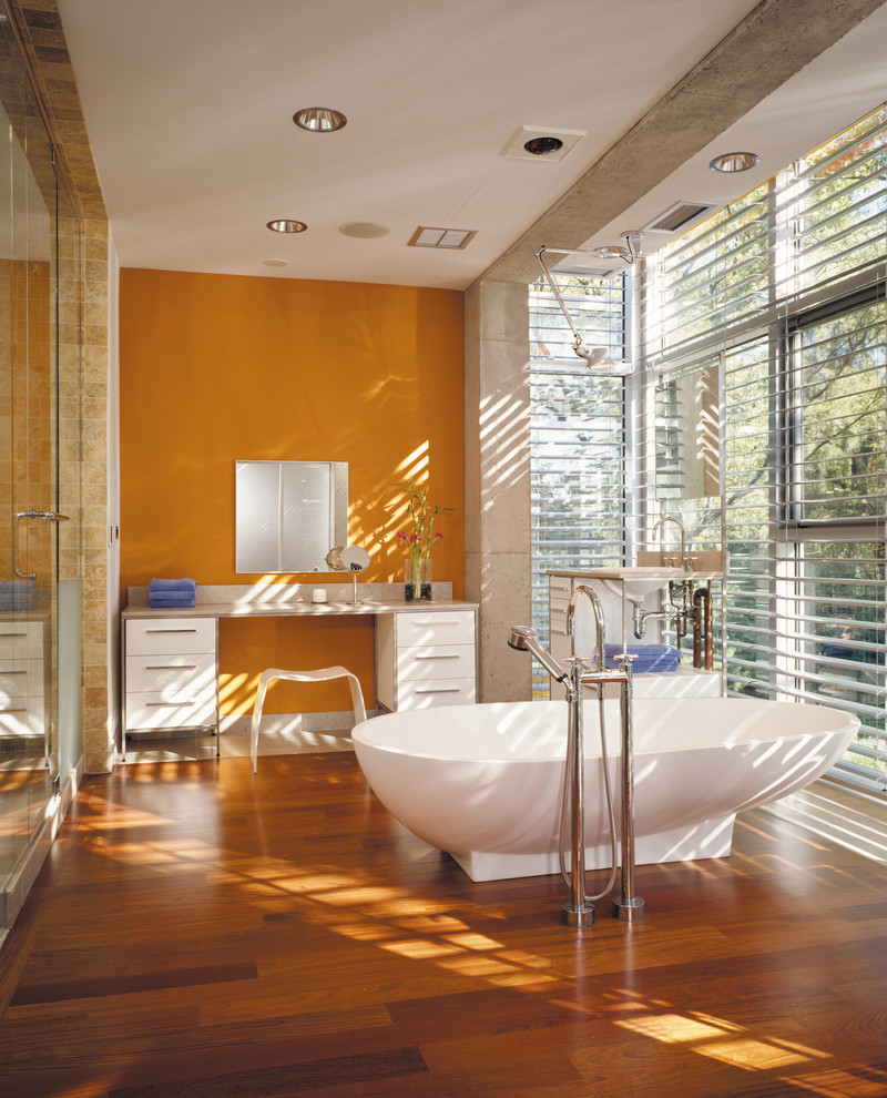 Industrial style bathroom with a dash of orange