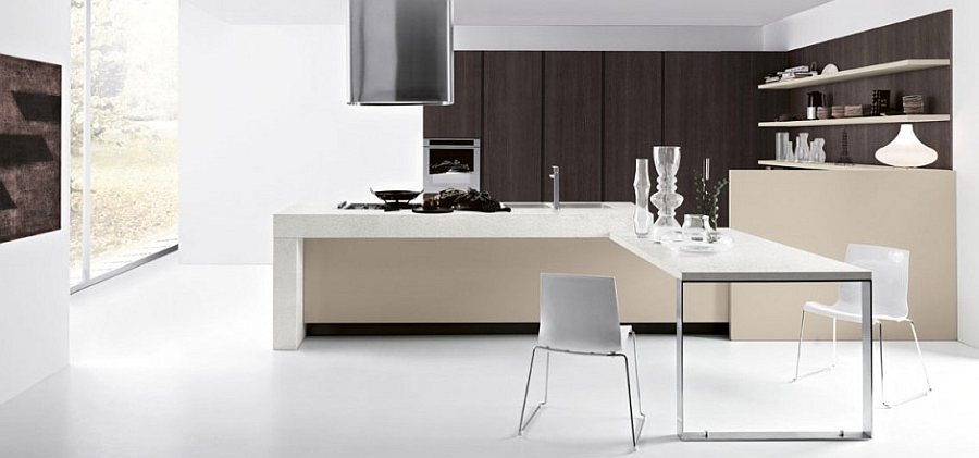 Kitchen island with an extended dining table turns the space into a social zone