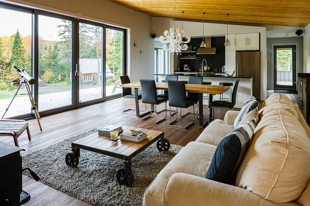 Large glass doors connect the living room with the garden outside