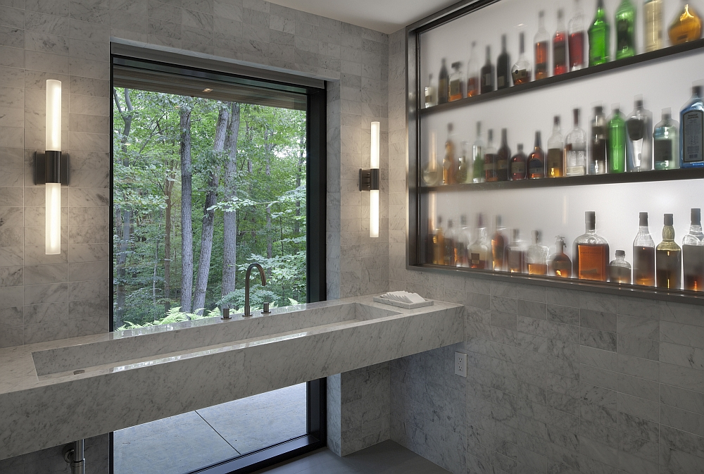Large windows make sure the forest canopy becomes a backdrop for the interior