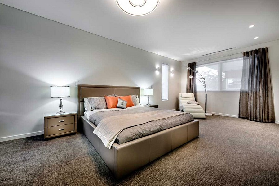 Luxurious bedroom in neutral hues with a pop of orange