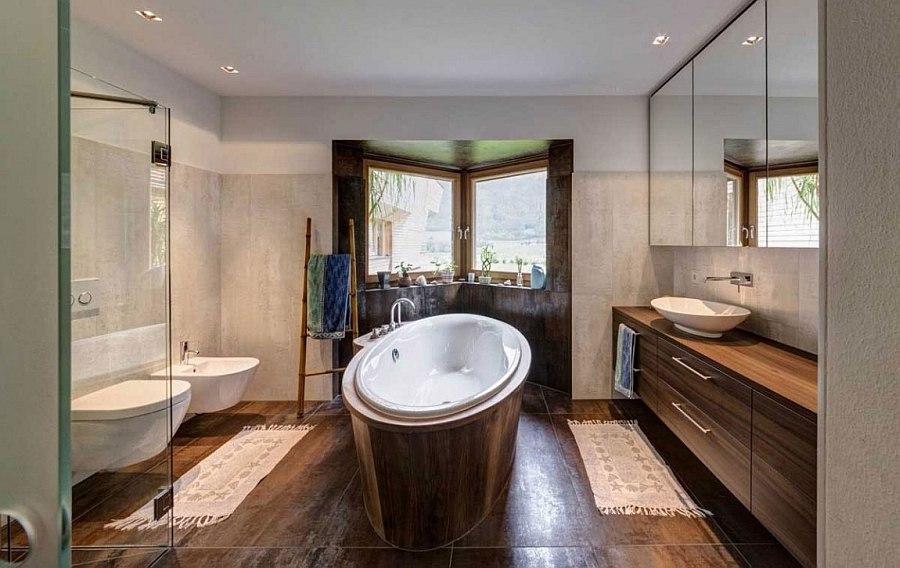 Modern bathroom with standalone bathtub and wooden vanity