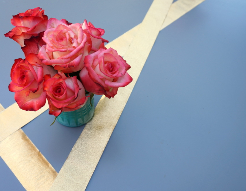 Red roses in a turquoise vase