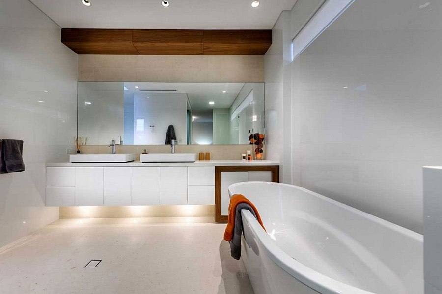 Restrained use of wood in the posh bathroom as an accent addition