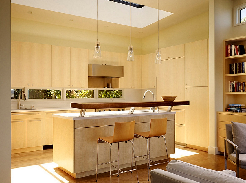 Skylight brings ample natural ventilation into the transitional kitchen [Design: John Maniscalco Architecture]