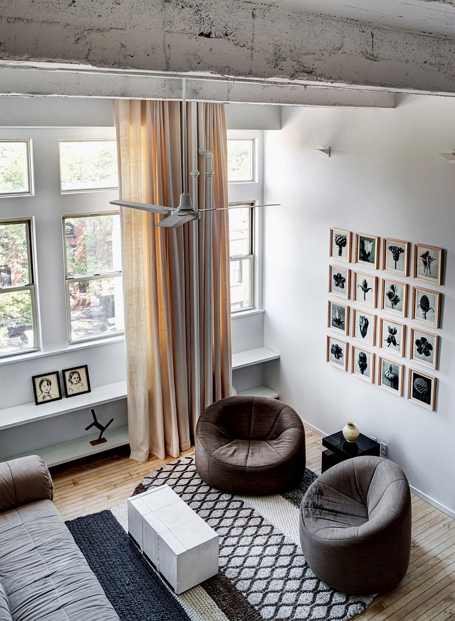 View of the living room with a gallery wall from the mezzanine level