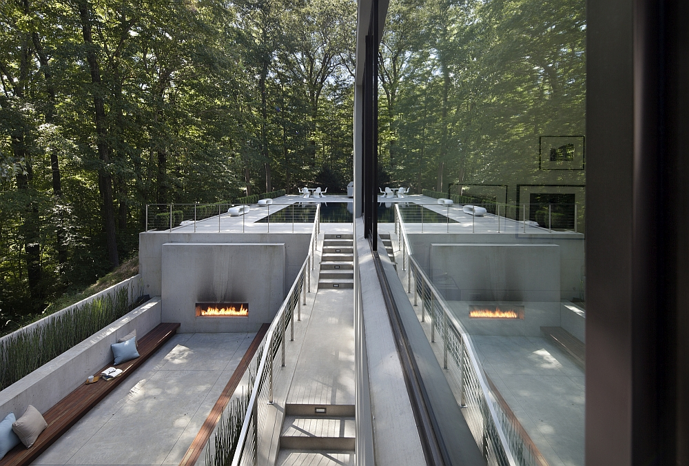 Walkway leading to the sunken outdoor lounge and the pool