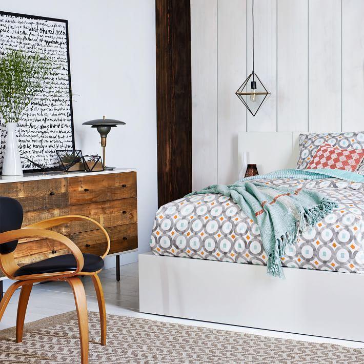West Elm Prism Pendant in a modern bedroom