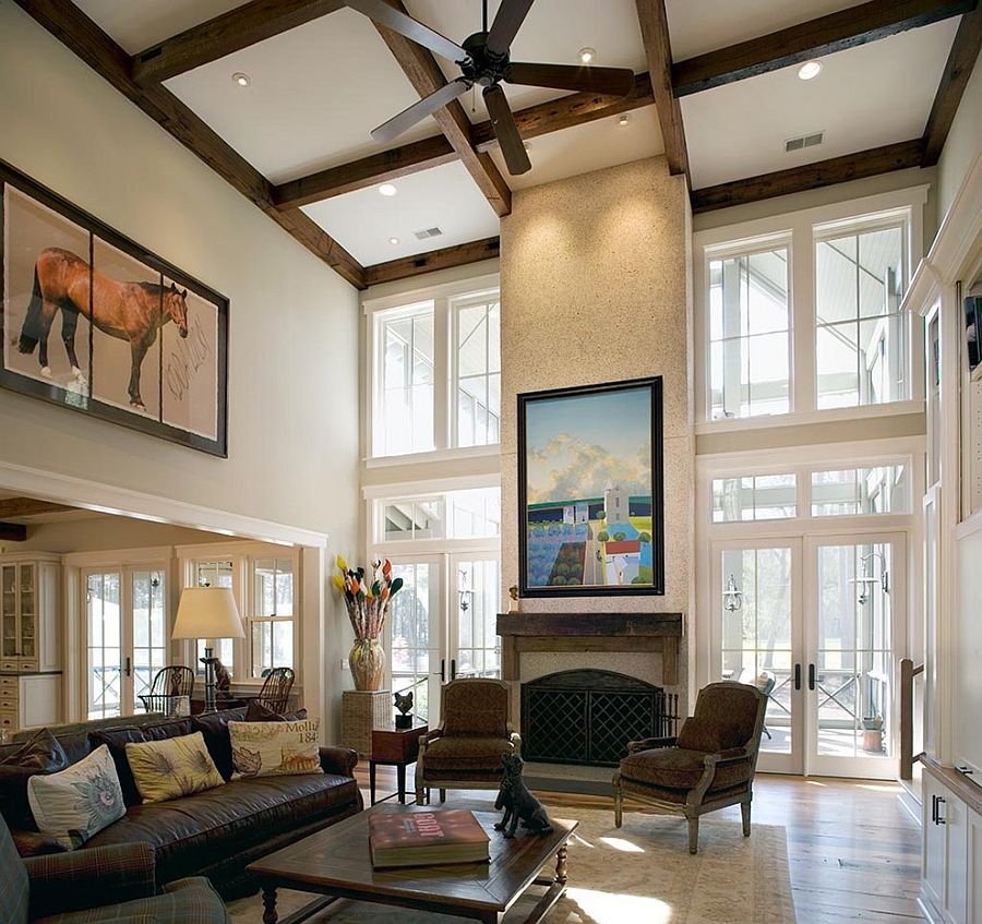 Fireplace, ceiling beams and wall art combine to give the living room a stunning ambiance [Design: Wayne Windham Architect]
