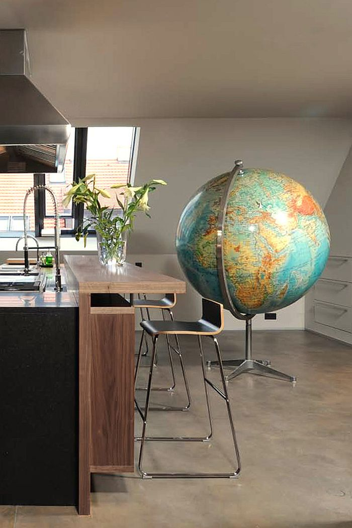 Giant globe in the kitchen stands out as an ingenious addition! [Design: Precious McBane]