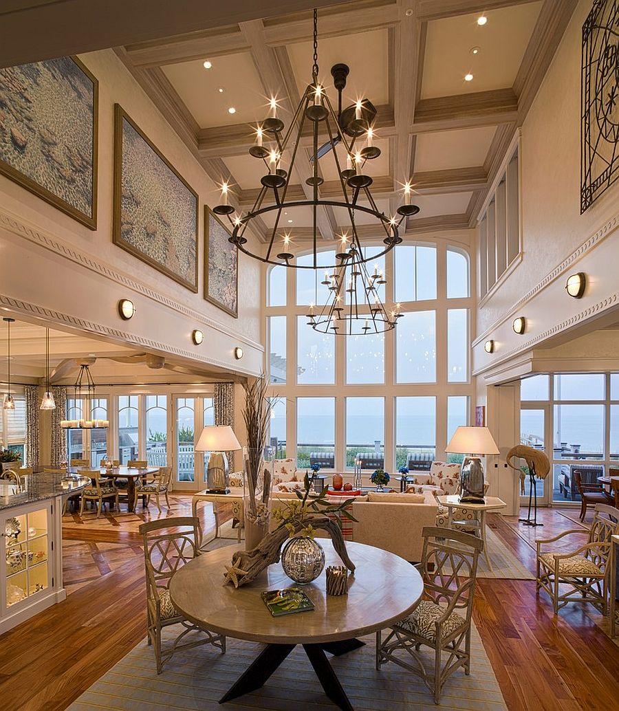 Lighting fixtures bring grandeur to the space [Design: Bruce Palmer Interior Design]