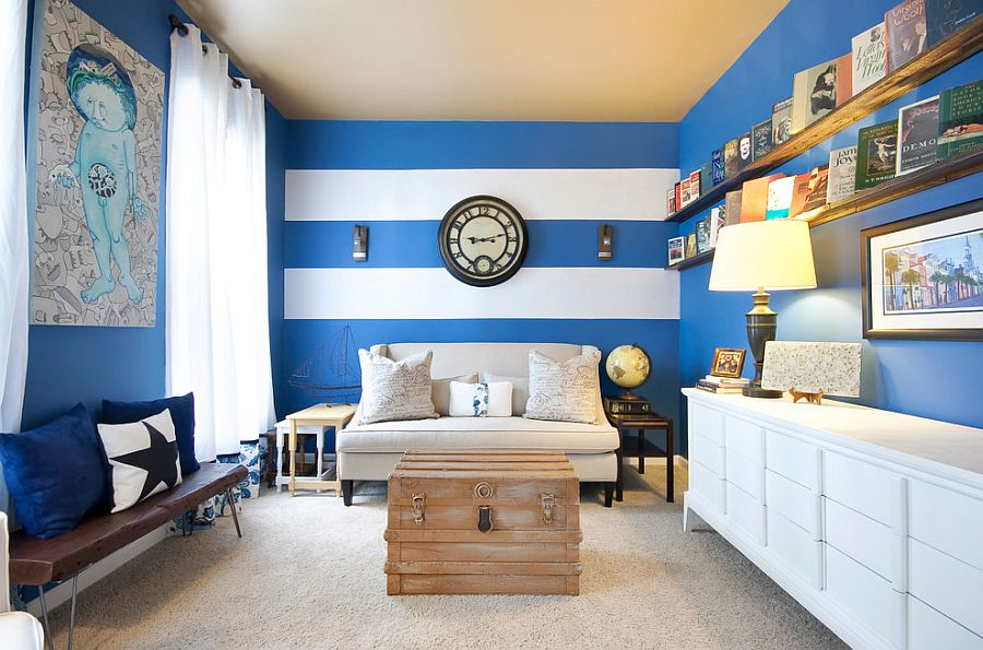 Narrow living room with a striped accent wall [Photography: Matthew Bolt Graphic Design]