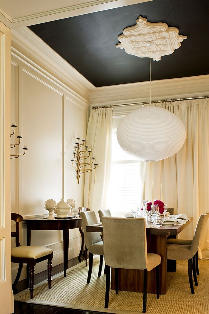 Pendant lighting steals the show in this dining room [Design: McGill Design Group]
