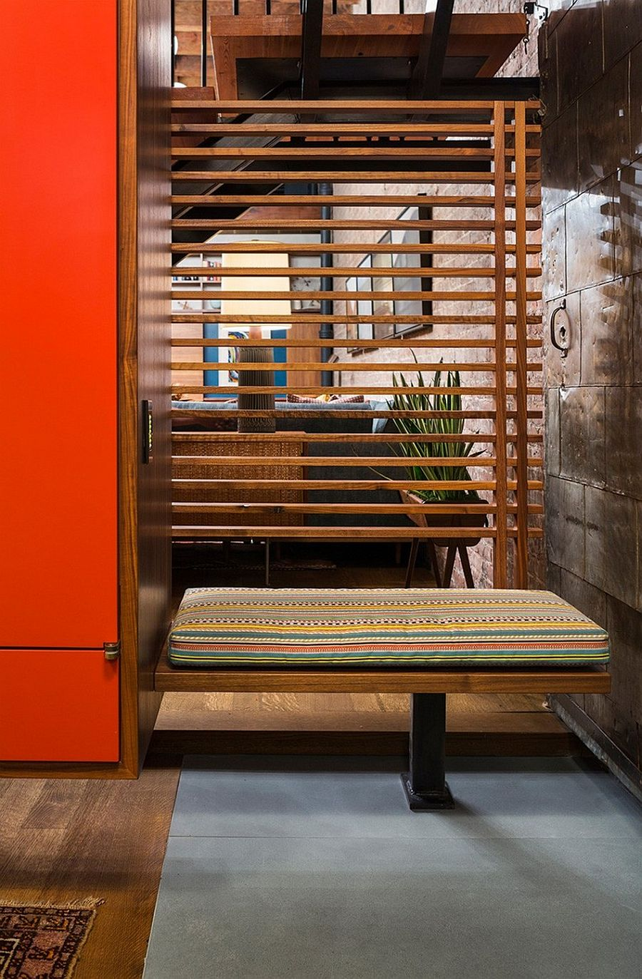 Wooden slats demarcate space even while allowing for visual continuity
