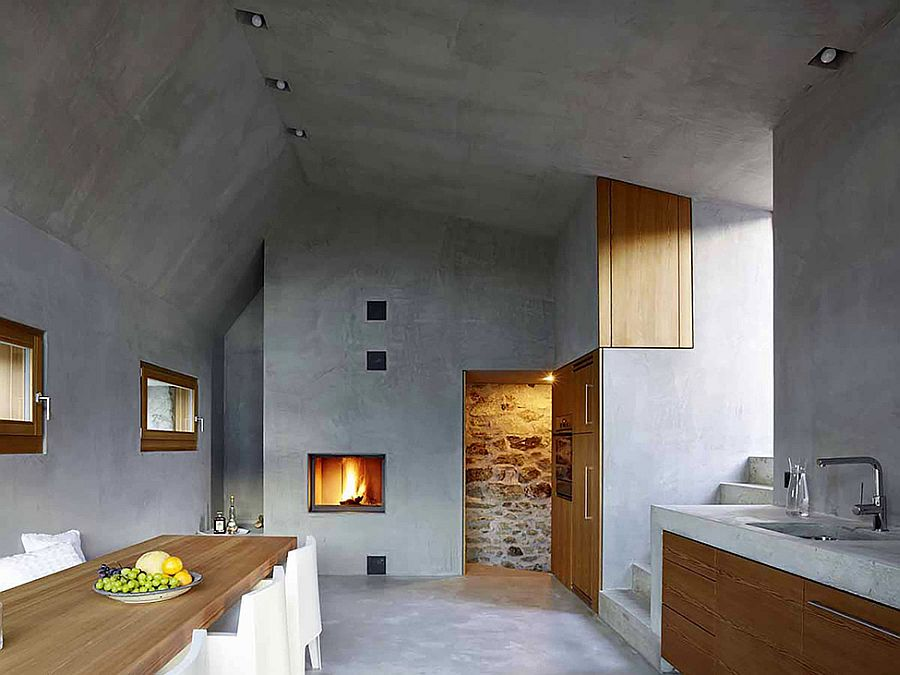 Beautiful fireplace and concrete walls shape the minimal setting