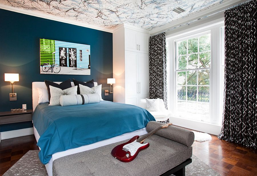 Posh boys' bedroom with a beautiful blue accent wall and creative ceiling