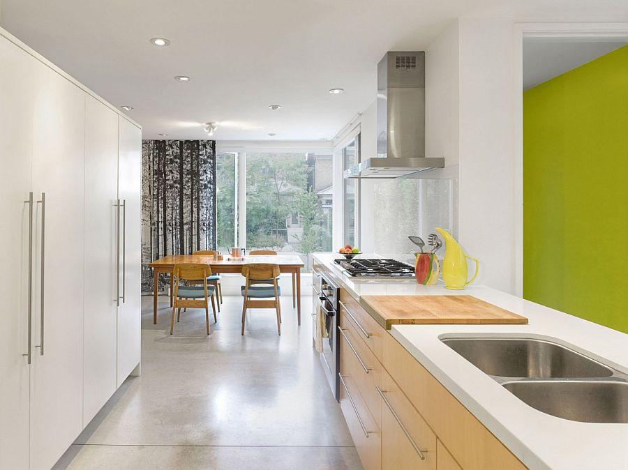 Sleek shelves help shape a creative and organized kitchen