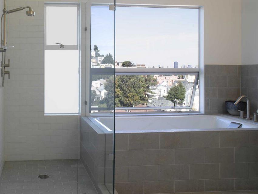 Tiled tub in a modern bathroom