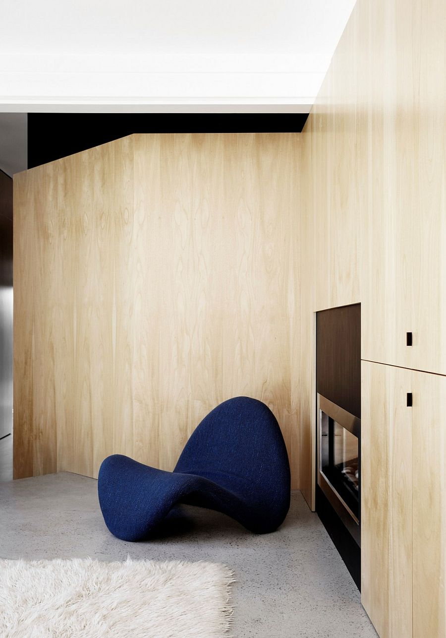 Wooden walls add natural warmth to the interior