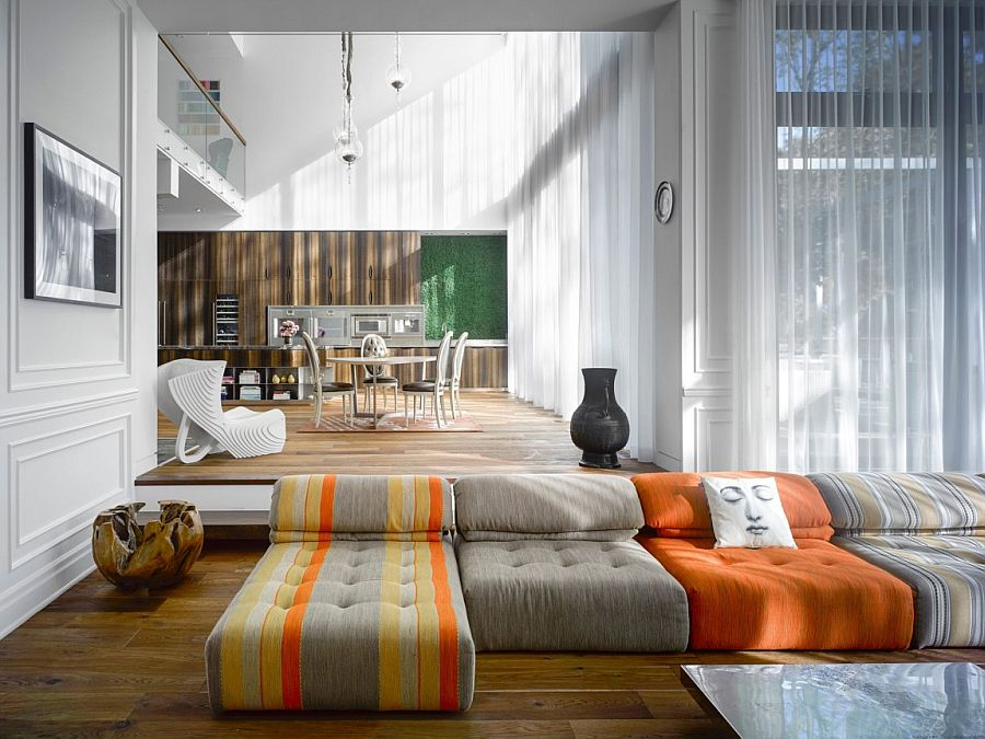 Colorful couch creates an informal, playful ambiance