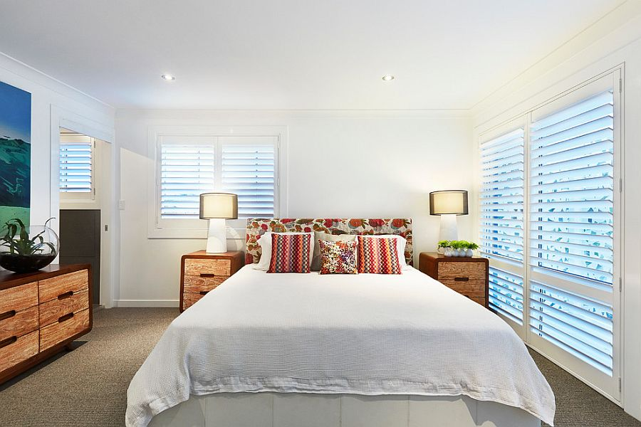 Contemporary bedroom in white with lovely visual symmetry