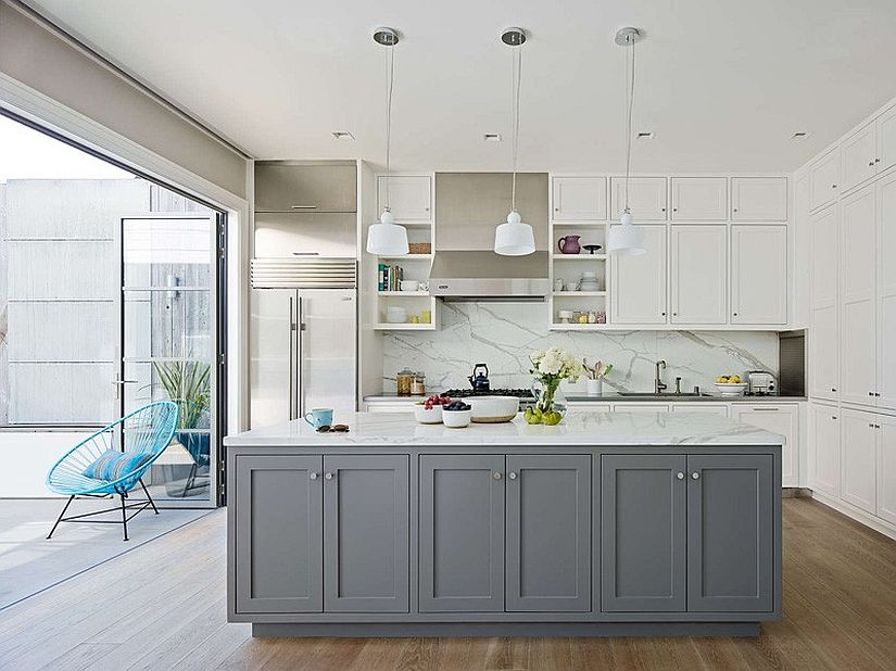 Contemporray white kitchen with a smart gray island