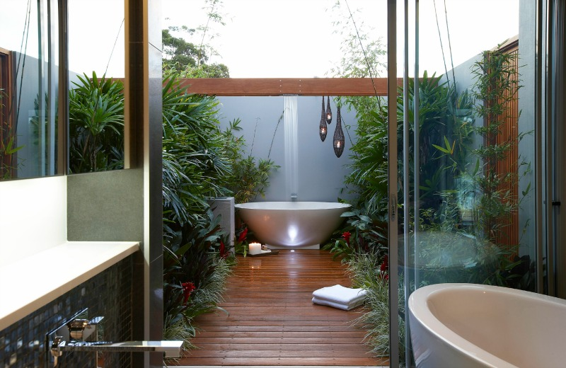 Yes, this bathroom has two tubs—one inside and one out!