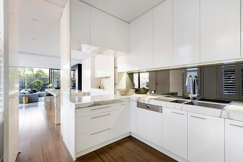 Kitchen space from the inside extends to the contemporary addition outside