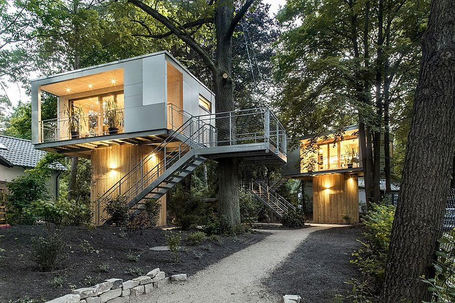 Lovely lighting adds to the appeal of the creative treehouse residences