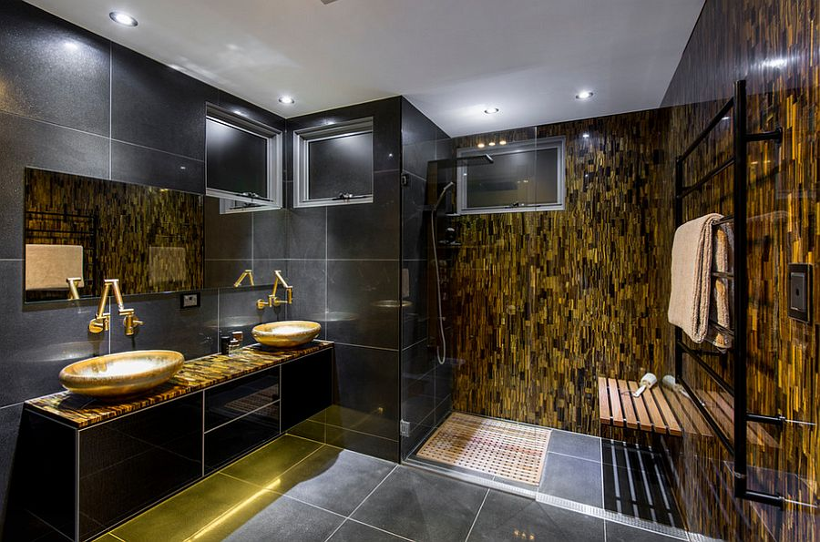 Red Tigers Eye stone feature wall adds gold to the glam bathroom