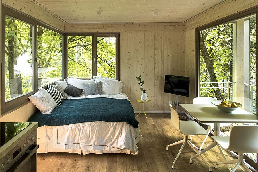 Small bedroom with a breakfast nook and private balcony