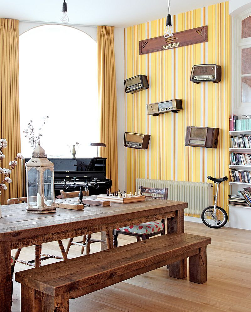 Striped yellow wallpaper in the modern dining room [Design: Avocado Sweets Interior Design Studio]