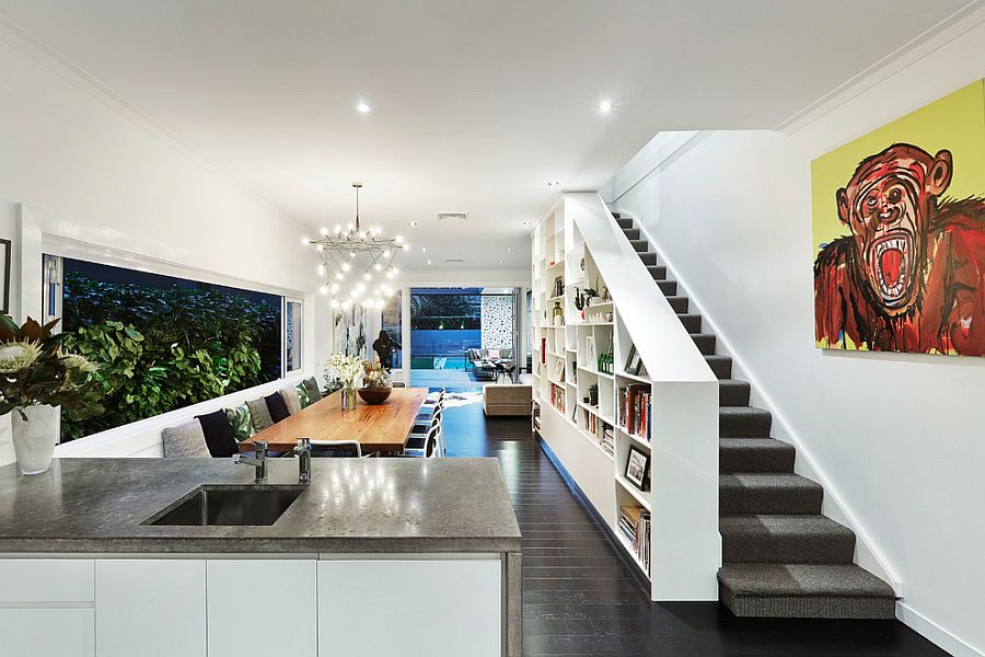 View of the contemporary dining room and bookshelf wall